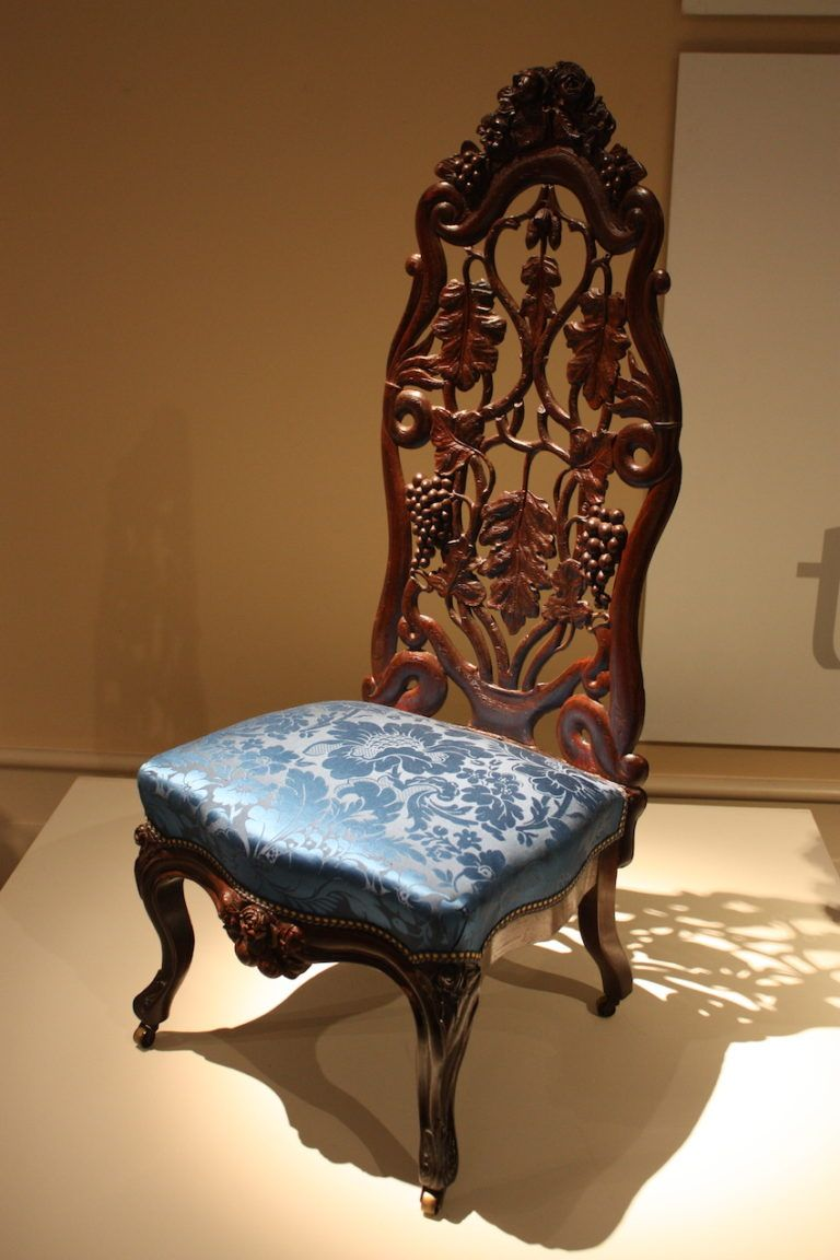 The chair is carved and laminated rosewood with silk damask upholstery.