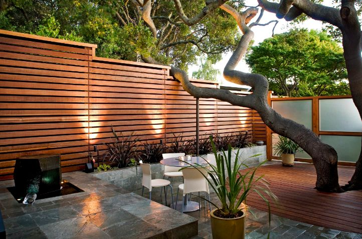 Small Backyard with a wood fence