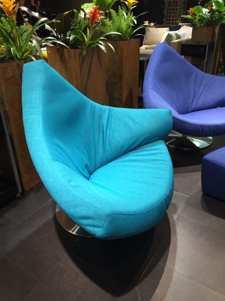 Unexpected shapes and textures give additional interest to colorful furnishings, such as this  triangular chair.