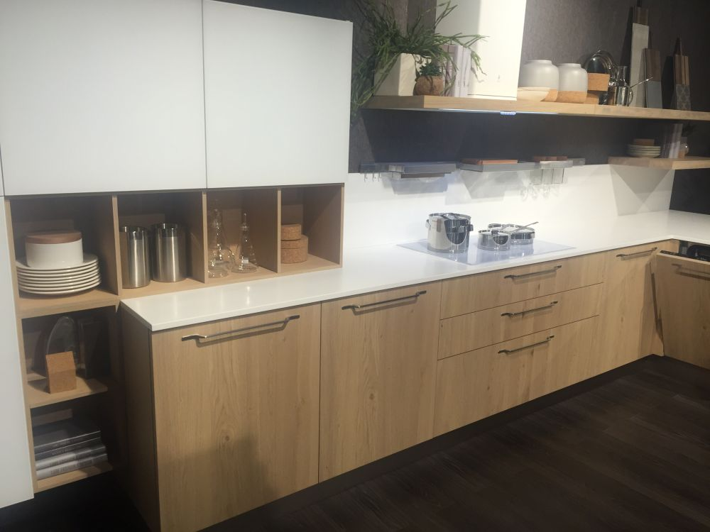 White countertop and brown wood cabinet