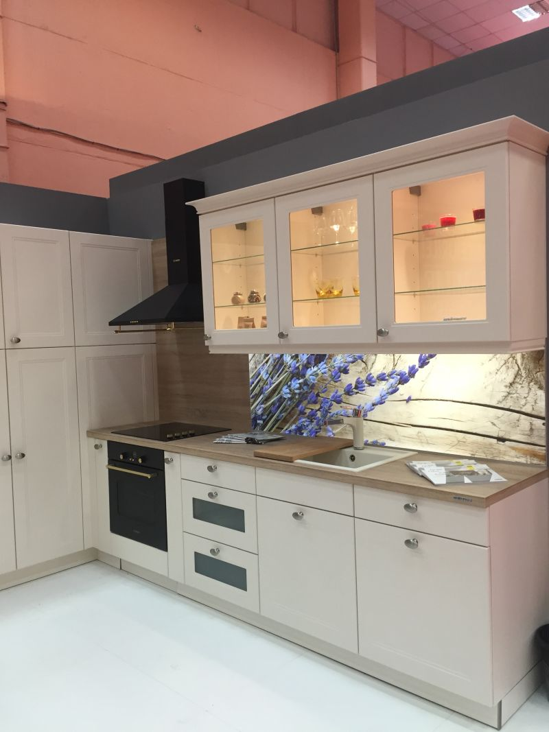 White kitchen design with Glass door cabinets