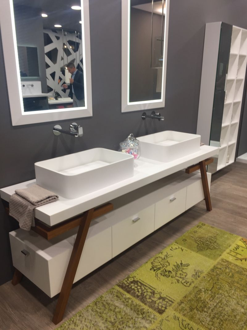 White porcelain double sink vanity with wood legs