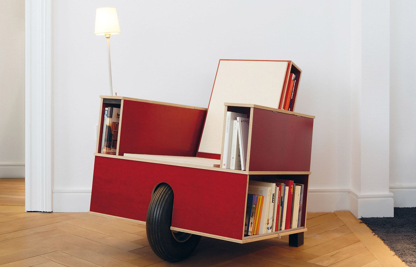 Wood chair on wheels with storage for magazine and books