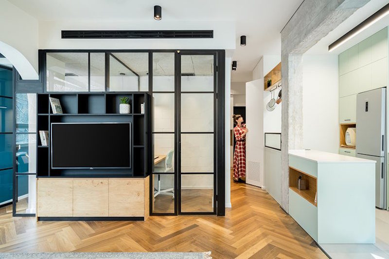 Small Apartment Merges Living And Working Spaces Into A Cozy Home