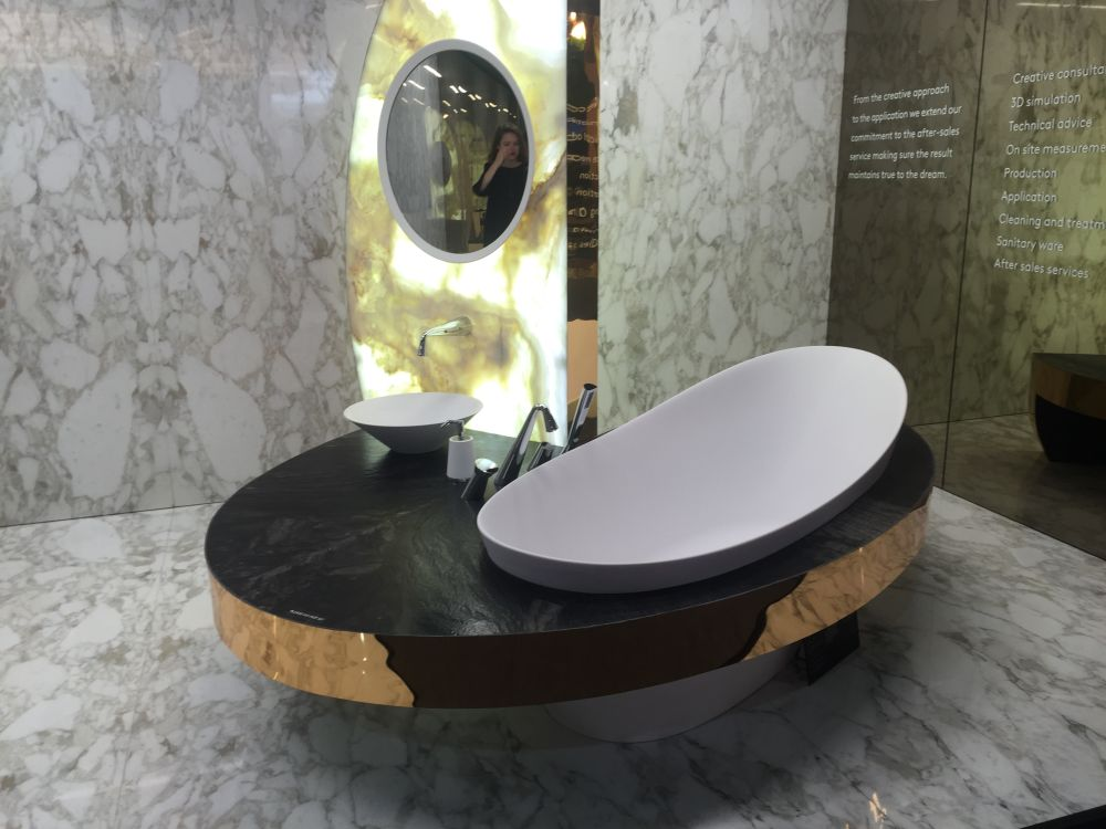 The metallic accents complement the translucency of the marble blocks and their colors