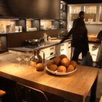 A wooden countertop extension can also serve as a dining surface as it does in this Marchi kitchen.