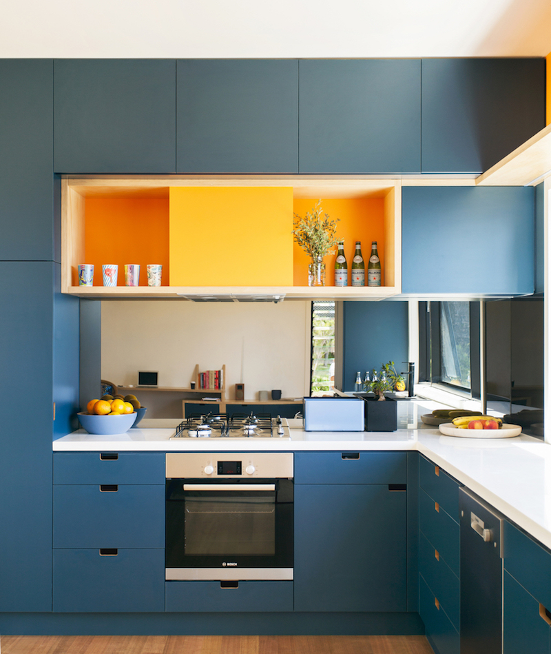 Orange Kitchen Accents: A Green, Prefabricated Home With A Living Room And Water Views