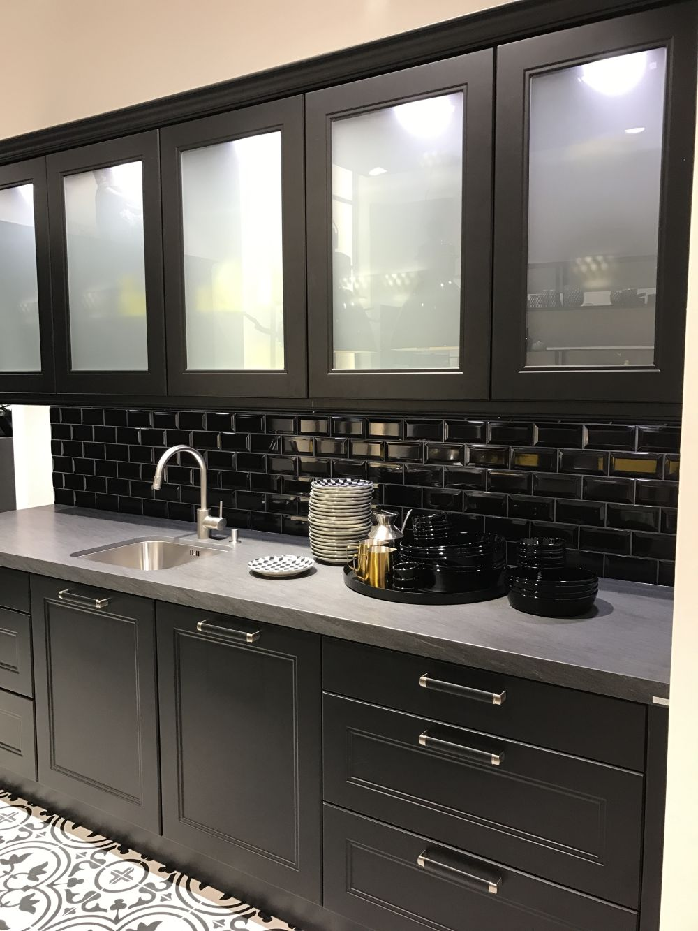 Glass kitchen cabinet doors and the styles that they work for Black kitchen cabinets