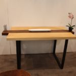 The two-tone wood and darker base contribute to the zen feel of the table.