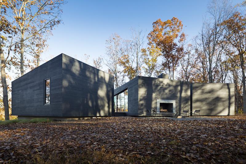 Black Box Family Home On The Riverside Embraces Nature