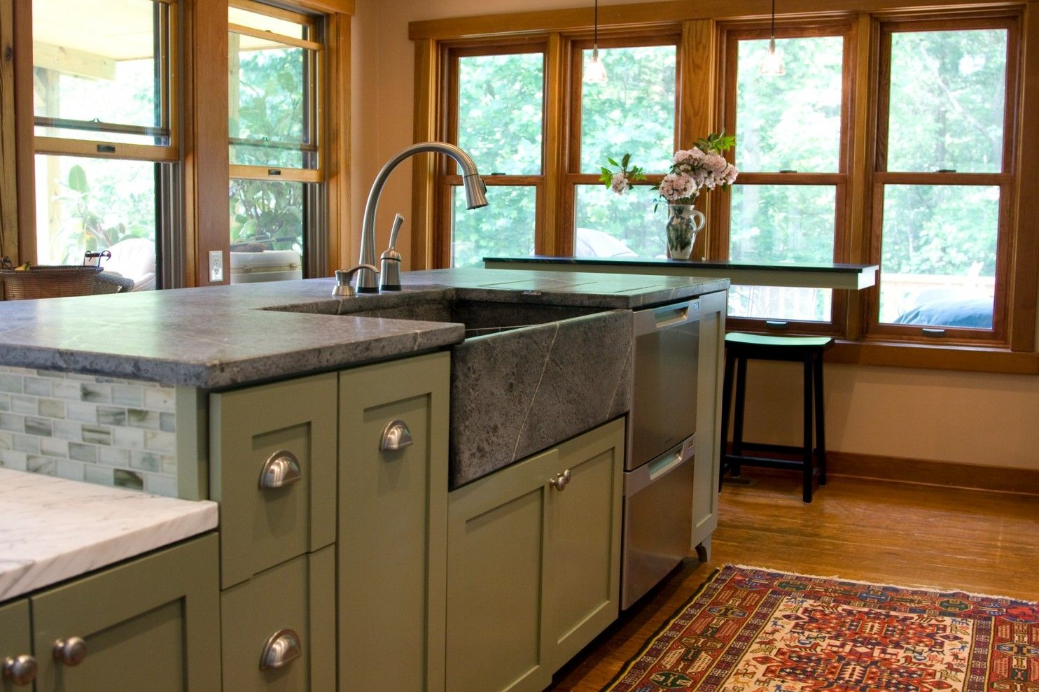 Soapstone countertops can be installed with a matching sink, like this design by Quality Stone Concepts.
