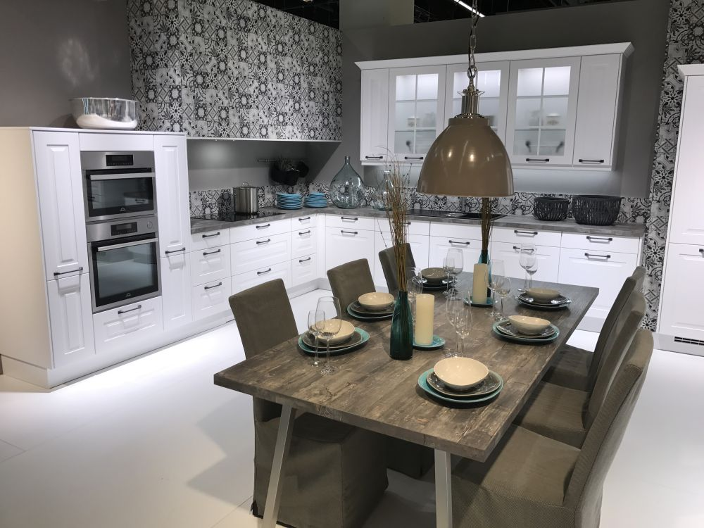 White frosted kitchen cabinets for a large l shaped layout