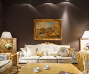 Decorating the living room with blue shade rococo furniture and framed gold baroque art