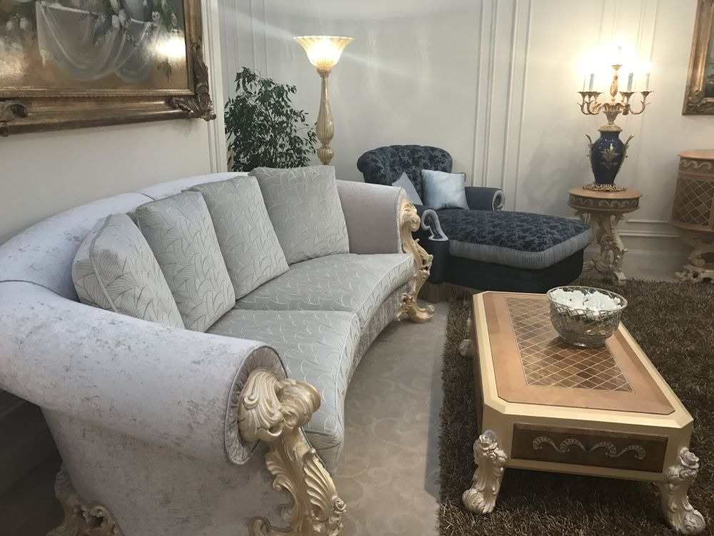 modern living room table sets. Substantial wooden legs on the table and large carved arms of sofa  play to Baroqie style Details Make Difference in Baroque Rococo Style Furniture