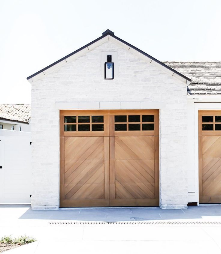 Accent White Painted Brick Exterior With Wood Doors
