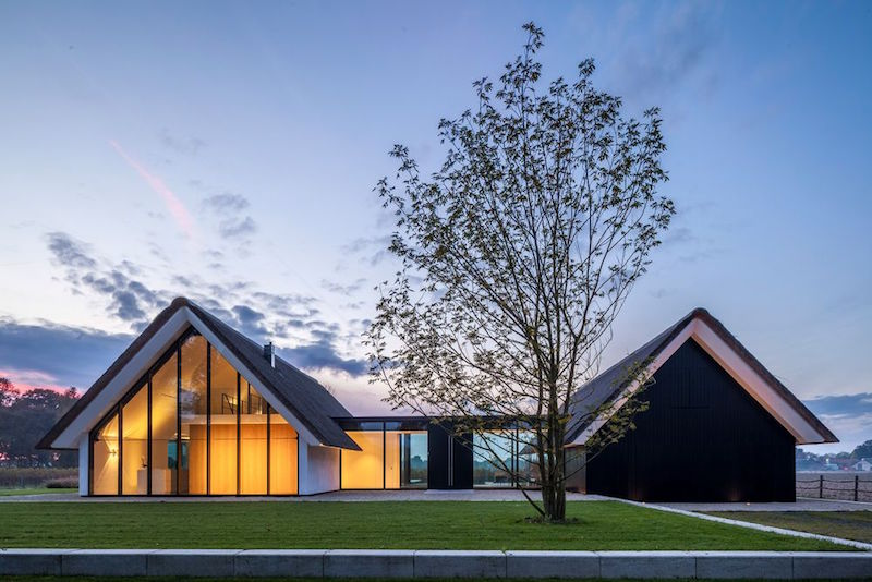 An H Shaped Home With A Greenhouse Like Extension
