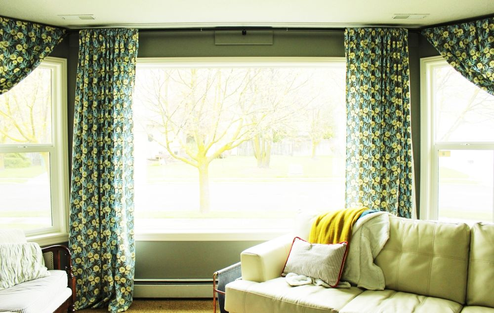 How to hang curtains a basic guide Where to hang pictures in living room