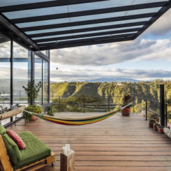 Las Penas House features a wooden deck with hammock