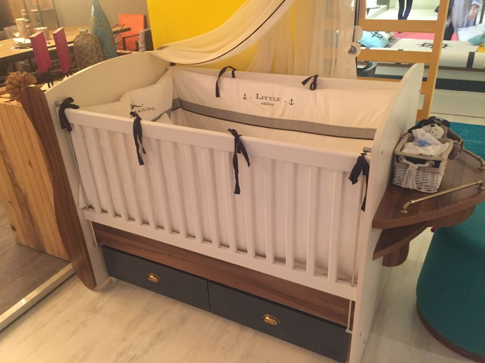 You could squeeze in some storage drawers under the crib and even add storage to the sides