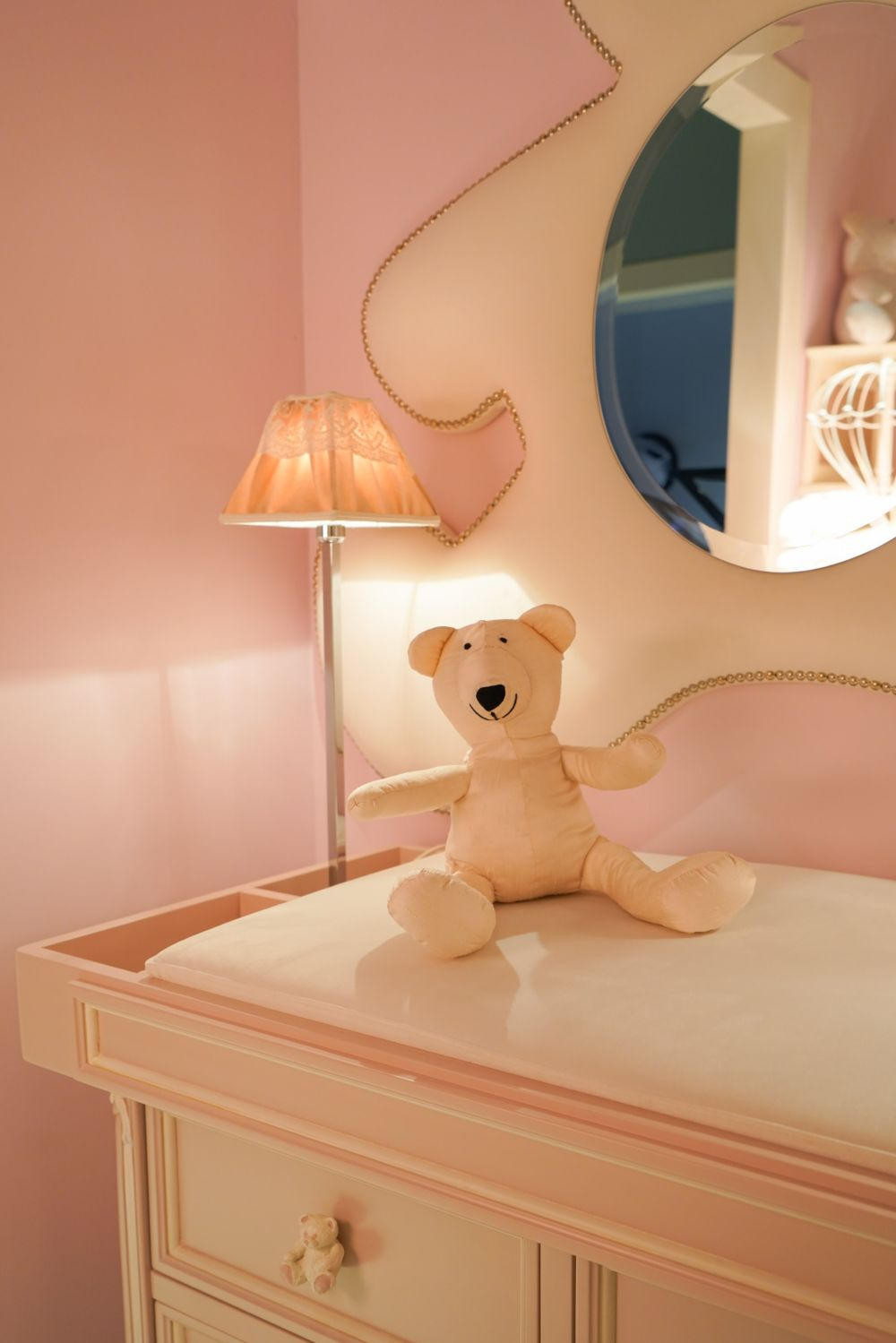 Notice the cute little teddy bear drawer knobs installed on this changing table. They match the mirror