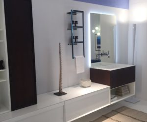 White Bathroom Design With A Stylish And Creative Mirror Featuring Backlit