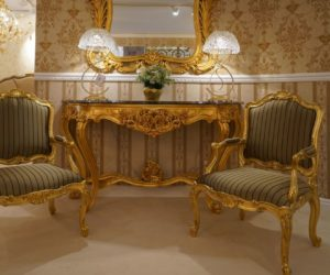rococo furniture - gold armchairs and narrow entryway table - baroque mirror