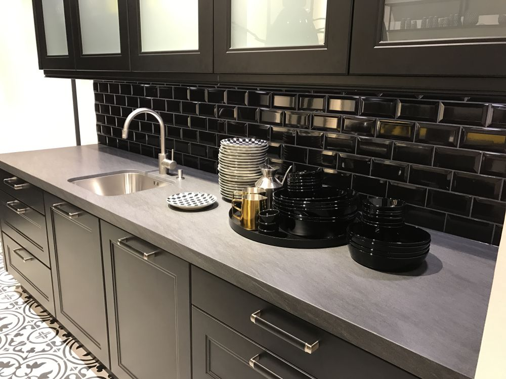 Black subway tiles look classy while also standing out and being timeless