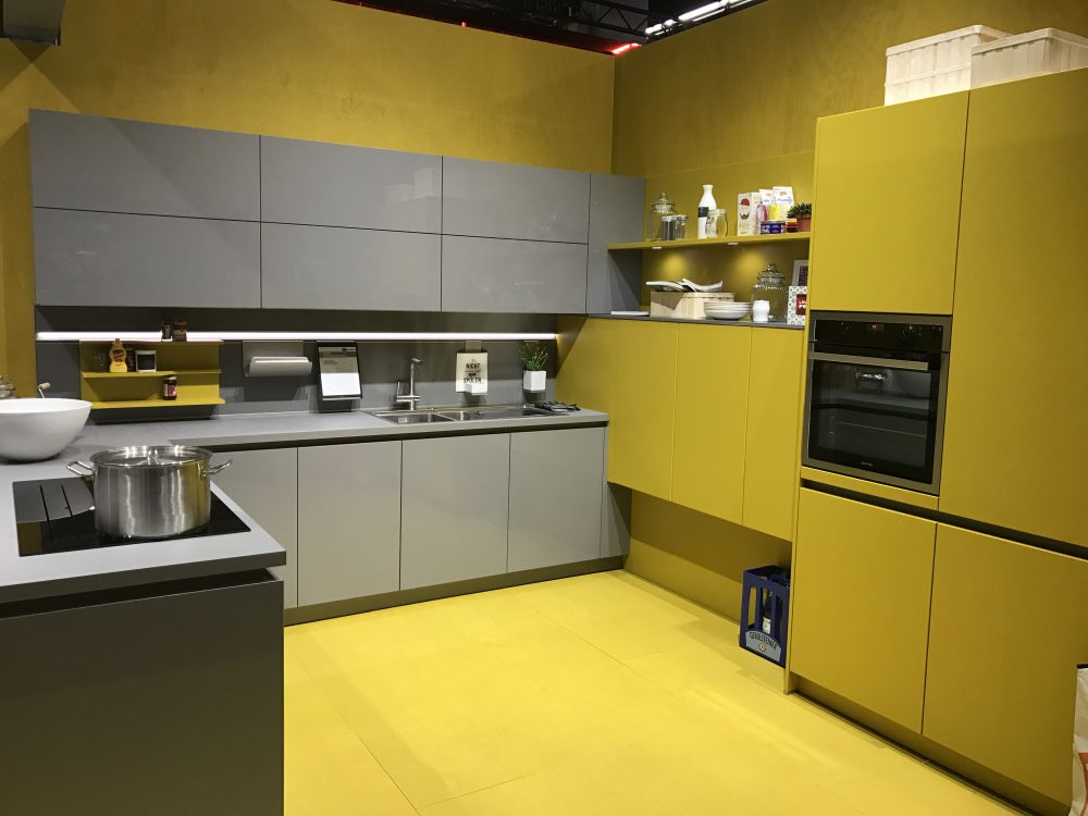 Modern gray kitchen cabinets beat monotony with style for Modern yellow kitchen cabinets