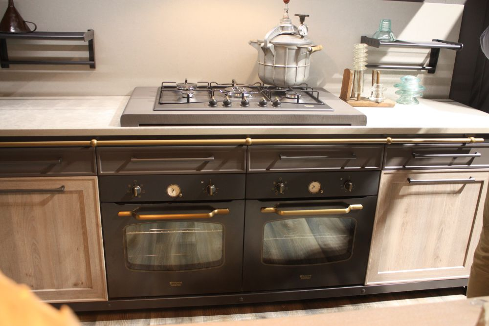 When working with retro-style appliances, it's important to maintain that look throughout the space