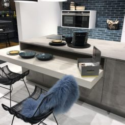 Large kitchen in gray with blue subway tiles