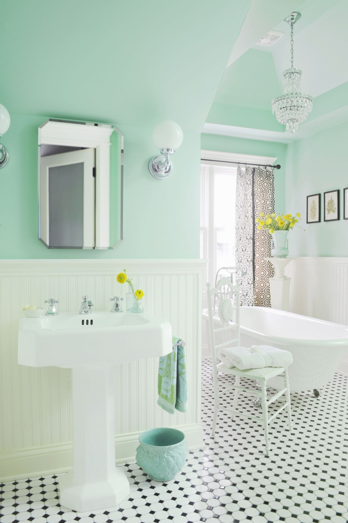 Mint bathroom interior design with black and white floor tiles previous next