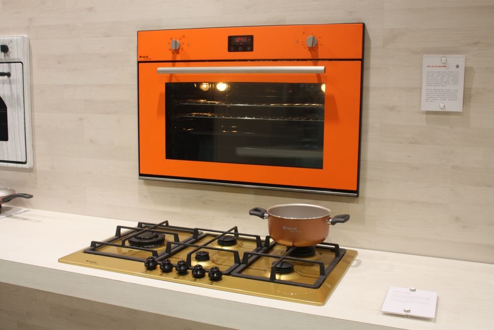 How about a bright orange oven for an otherwise neutral-colored kitchen? It could really brighten up the room