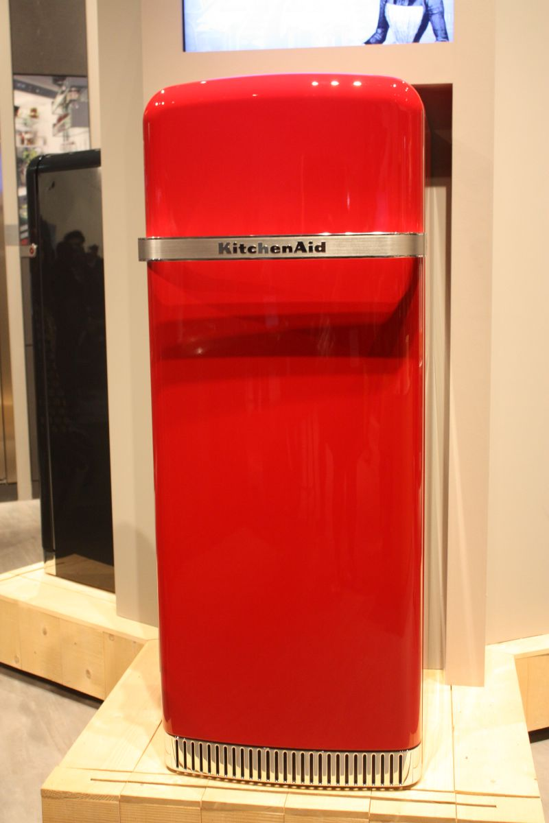 A red fridge is most likely to become the focal point of the kitchen and you can coordinate it with smaller matching elements