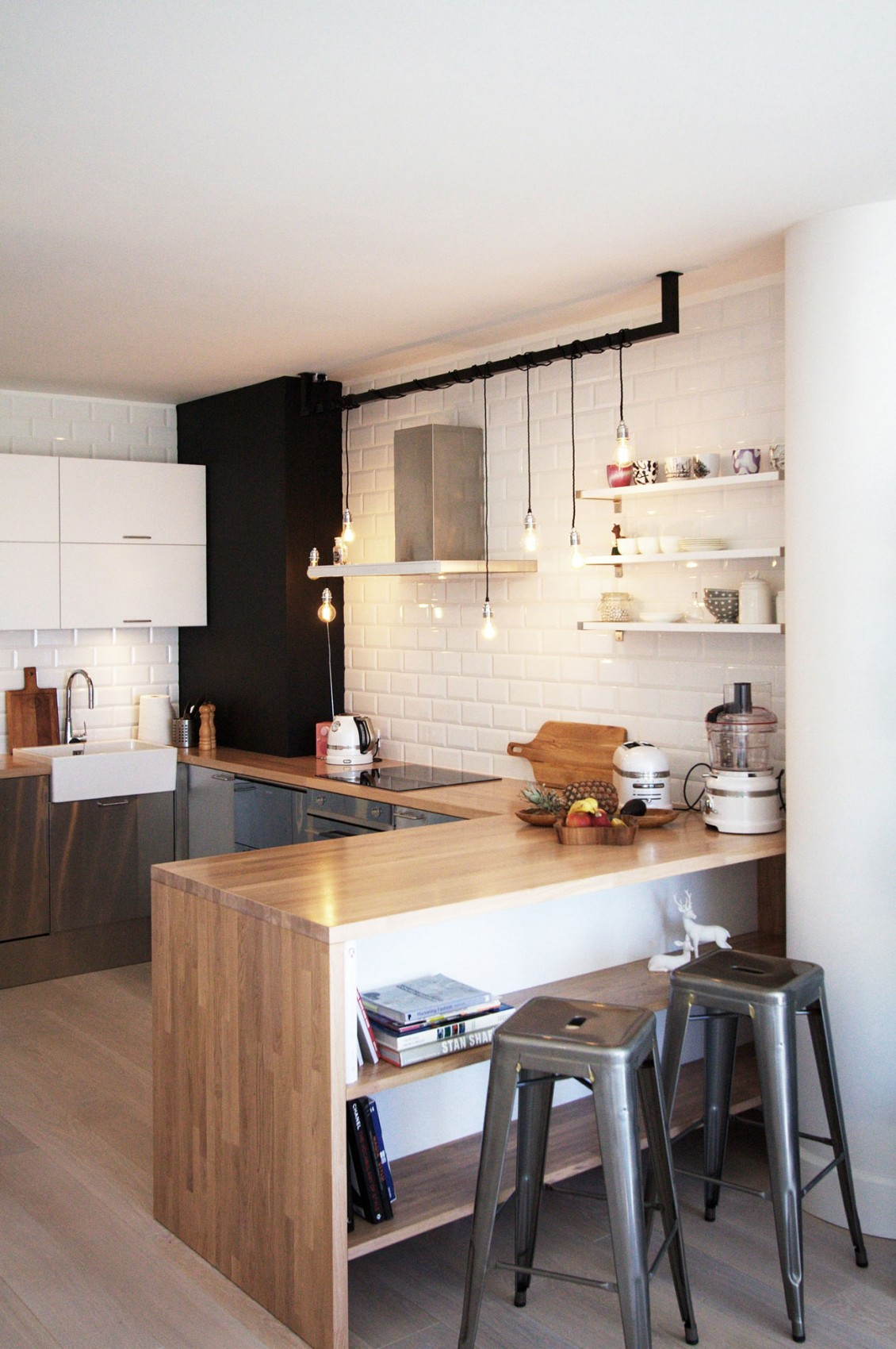 Subway tiles also look great when complemented by wood counters or by industrial pipe features