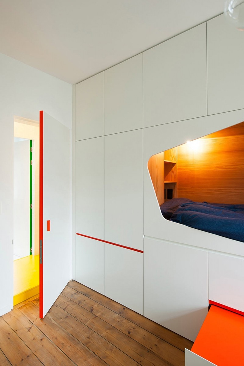 The door blends in with the wall perfectly when closed and has a brightly colored edge