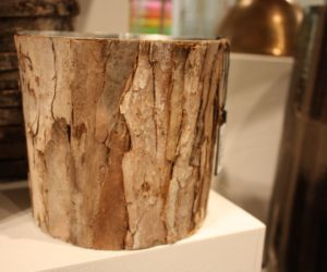 A bark-covered bucket is perfect for plants or storage.
