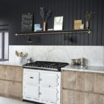 Black kitchen beadboard wood cabinets