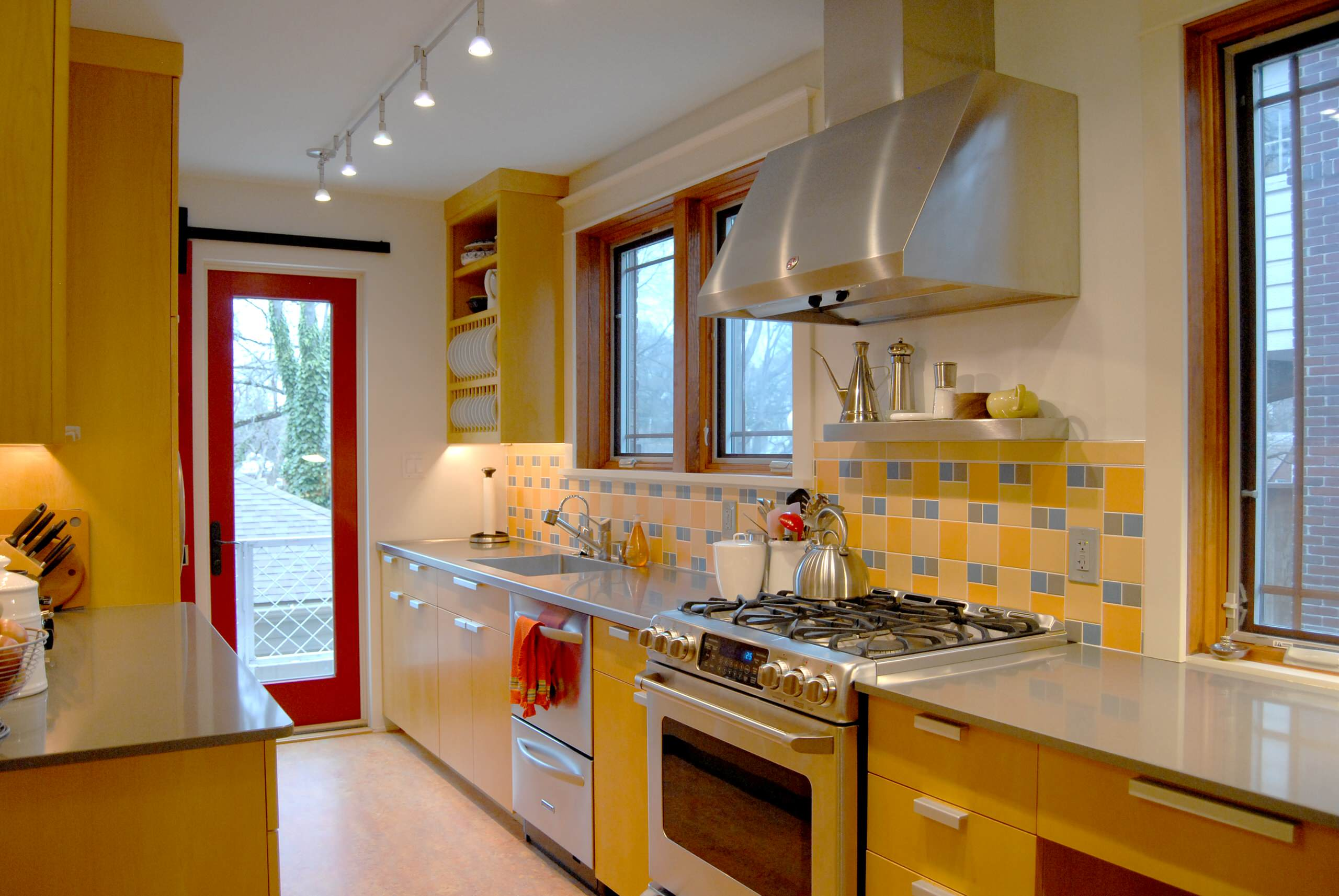 100 beautiful kitchens to inspire your kitchen makeover for Buttery yellow kitchen cabinets