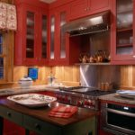 Country kitchen red cabinets wood backsplash