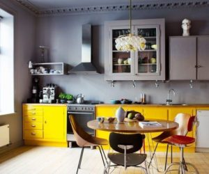 Gray kitchen yellow cabinets wood floor