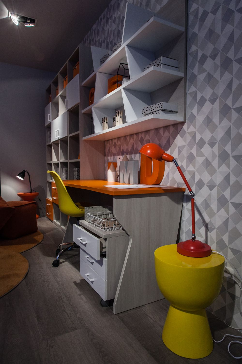 Bold colors and fun shapes can play a key role in making a desk look appealing for kids