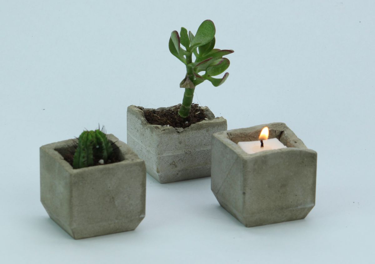 make your own trendy concrete plant and candle holders
