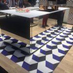 Mirrored Kitchen island with geometric floor tiles