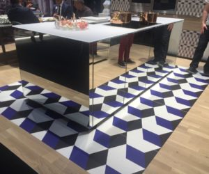 Mirrored Kitchen island with geometric floor tiles