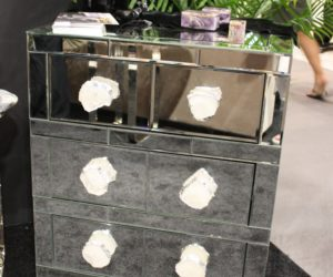 Mirrored nighstand with flowers on top