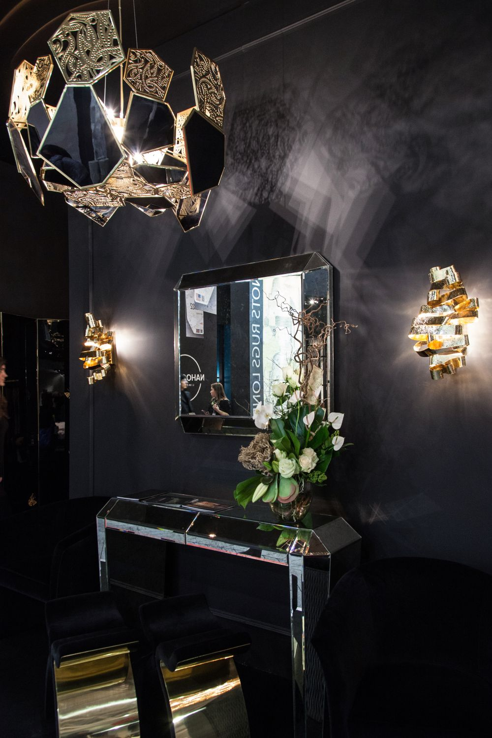 Here's a nice design trick: add a mirrored console table to a dark hallway to make it look more open