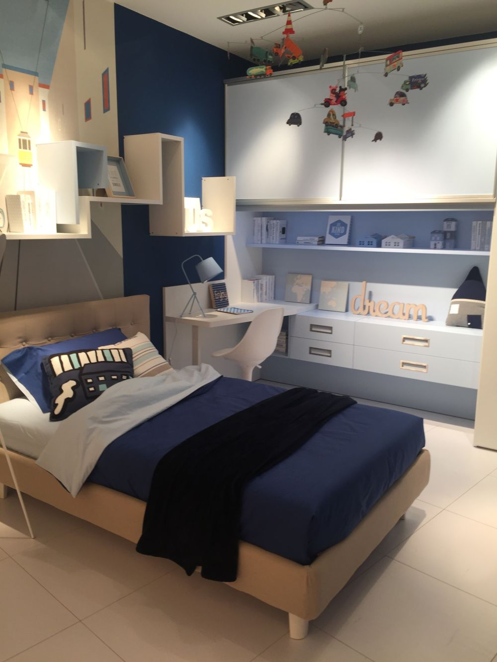 If space is limited, a desk can double as a nightstand if placed by the bed