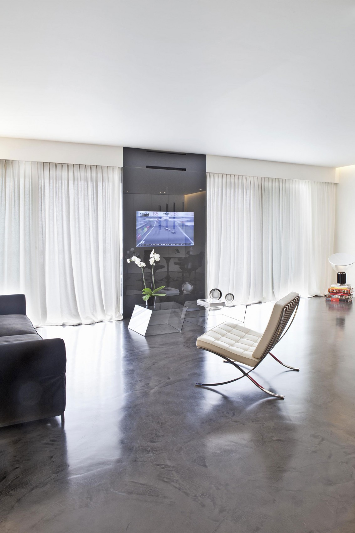 The iconic barcelona chair featured in stylish interior - Concrete floor living room ...