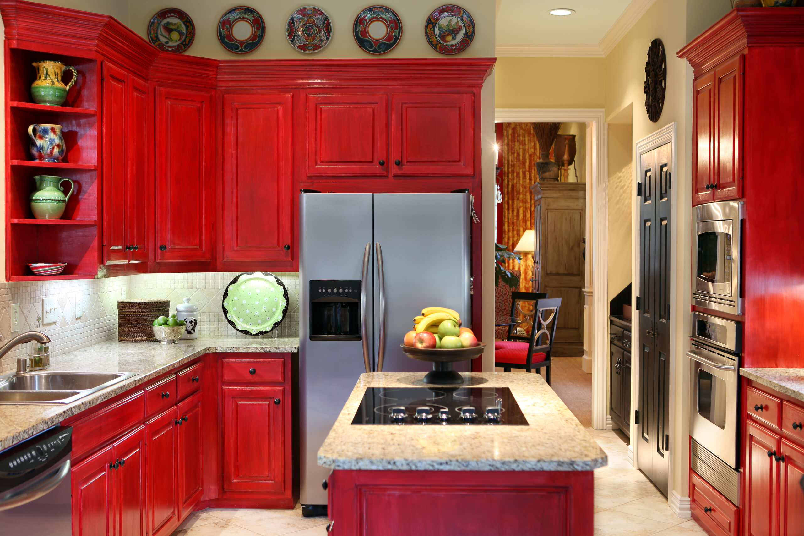 100 beautiful kitchens to inspire your kitchen makeover for Bright red kitchen cabinets