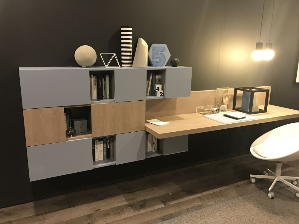 This desk looks like an extension of a wall-mounted storage module